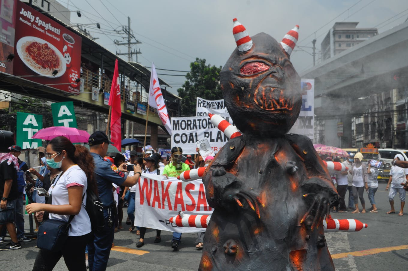 Coal is still king in the Philippines. A demonstrator dressed in a coal costume on a march outside the presidential palace