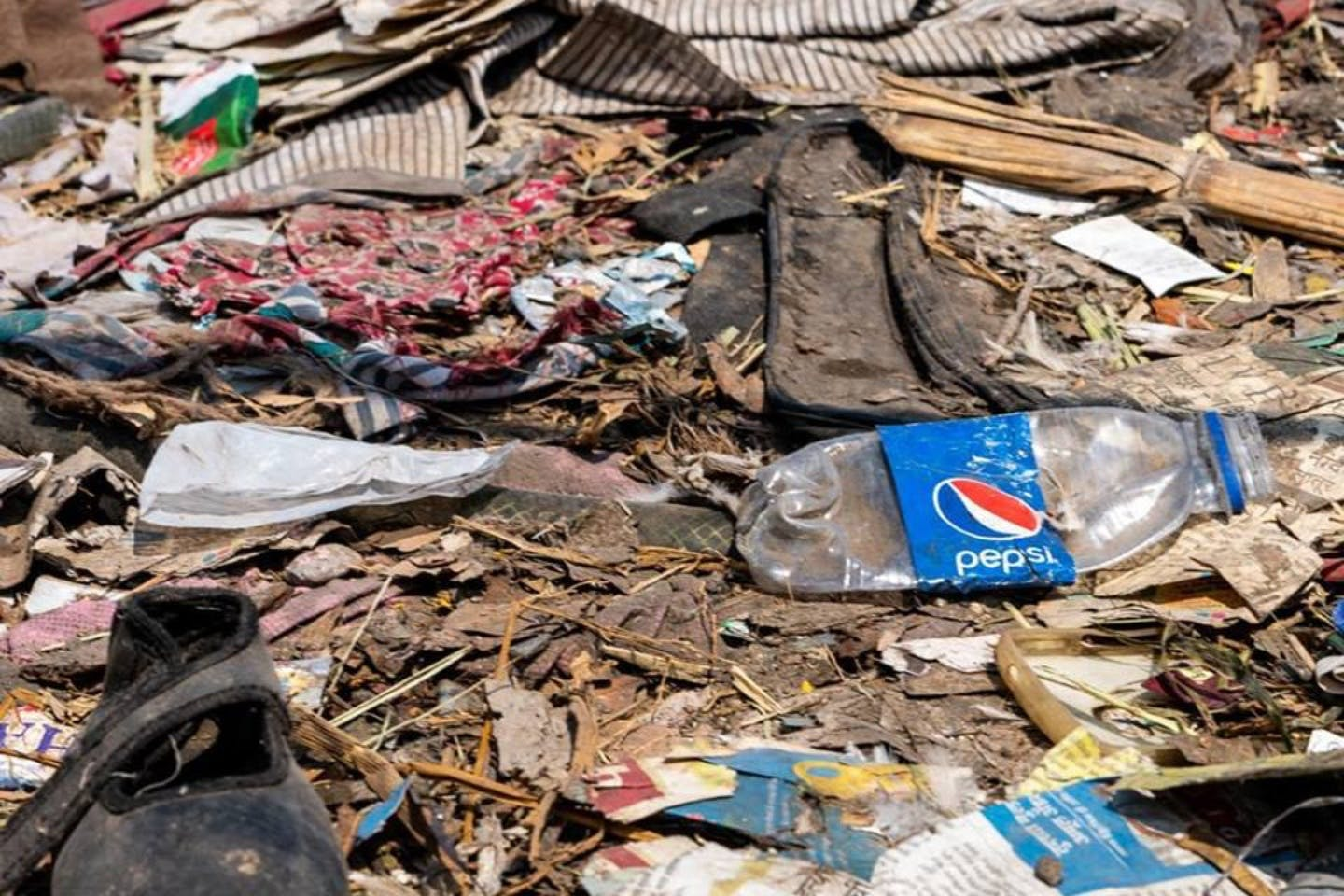 A Pepsi model lies amid other debris. Could plastic-using brands save the circular economy? Image: Eco-Business