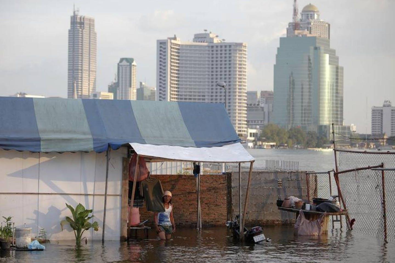 man in flooded home in BKK
