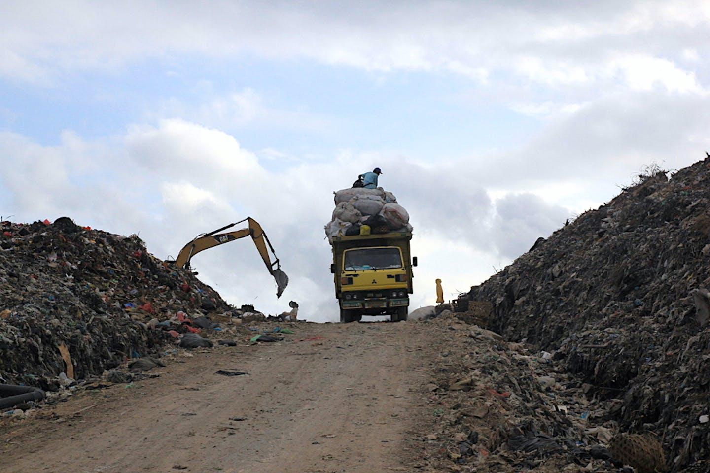 dump truck in a landfill in Indonesia