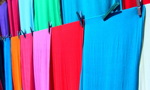 Tiny clothes fibres are washing into the oceans. What can garment makers do about the problem?