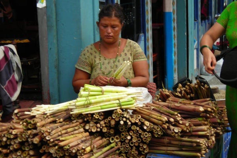nepal woman selling bamboo
