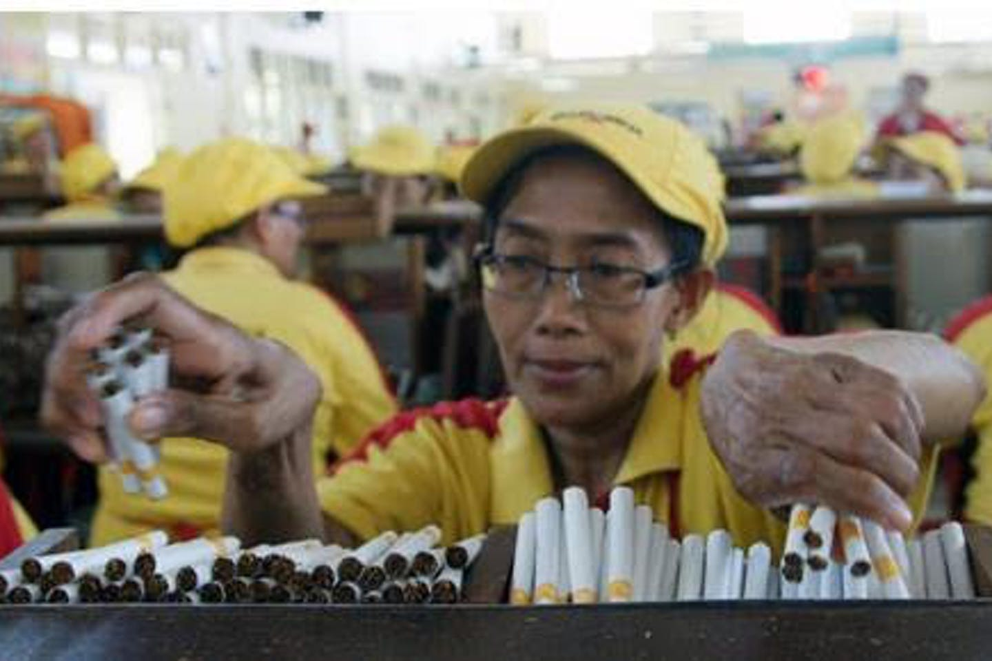 Indonesian woman in a cigarette factory