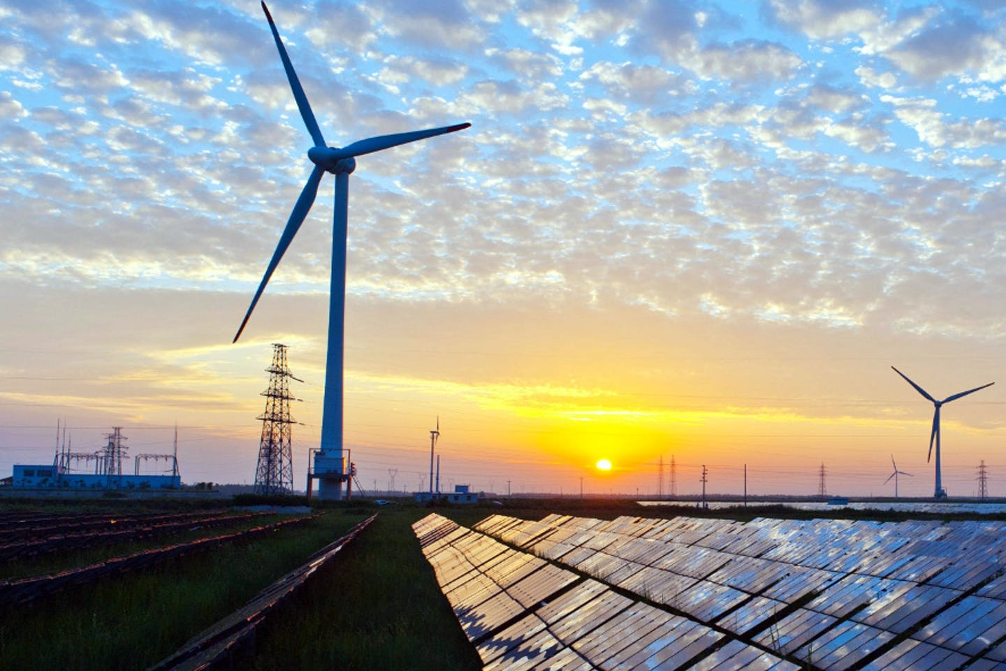 wind turbines and solar panels in asia