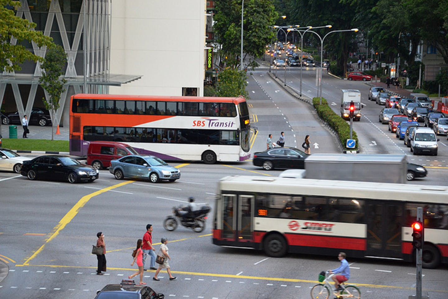 singapore road with commuters