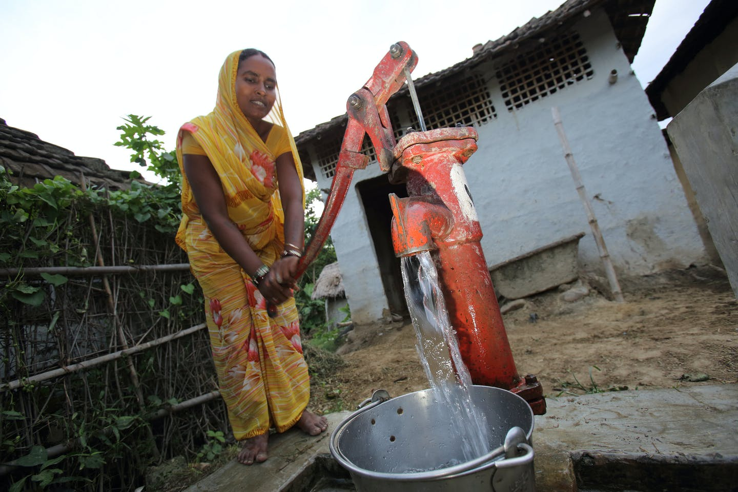 Woman in Nepal drawing water from a tubewell