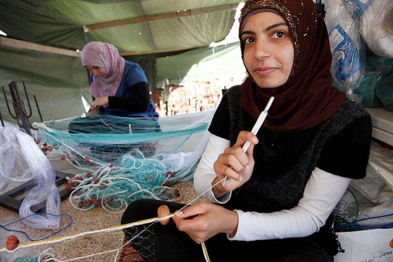 Syrian and Lebanese girls make fishing nets