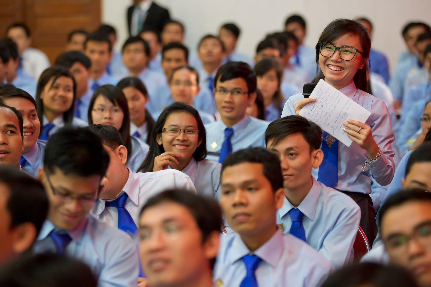 A student asks International Monetary Fund Managing Director Christine Lagarde a question at the Ecole Royale d'Administration December 3, 2013 in Phom Phen, Cambodia