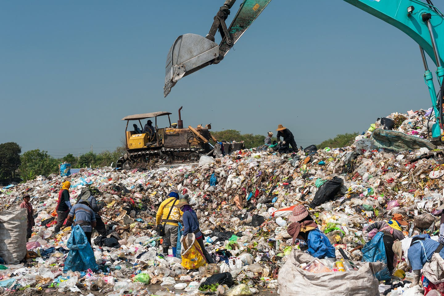 Scavengers pick through garbage collected at a landfill site in Thailand.