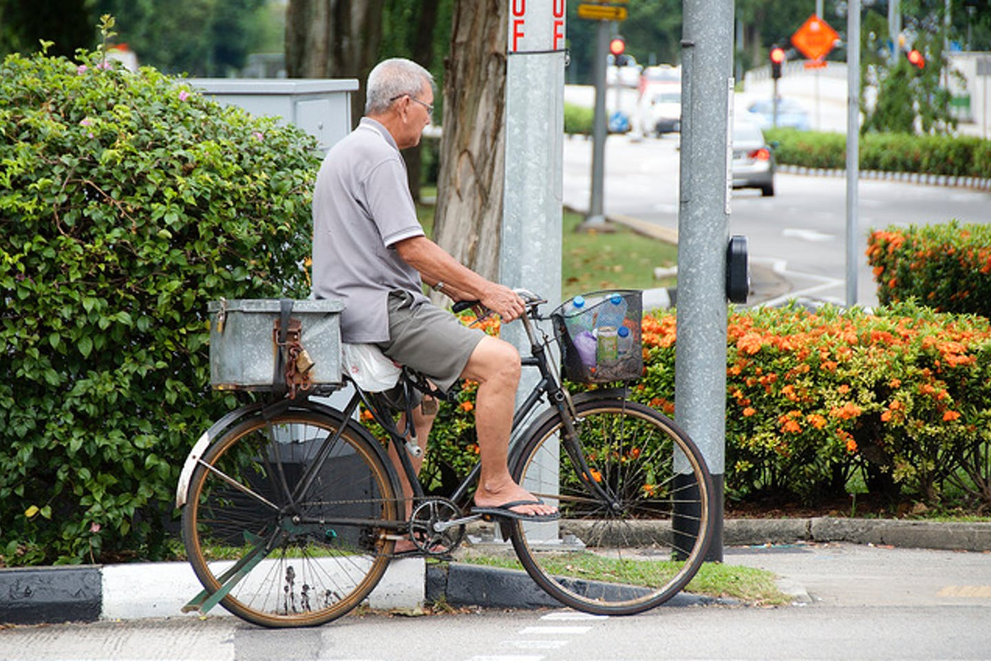 man cycles in Singapore