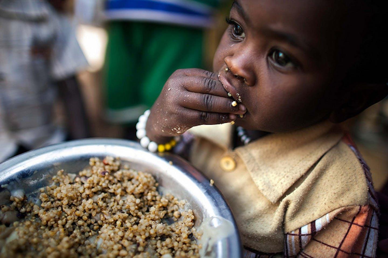 child eats lentils