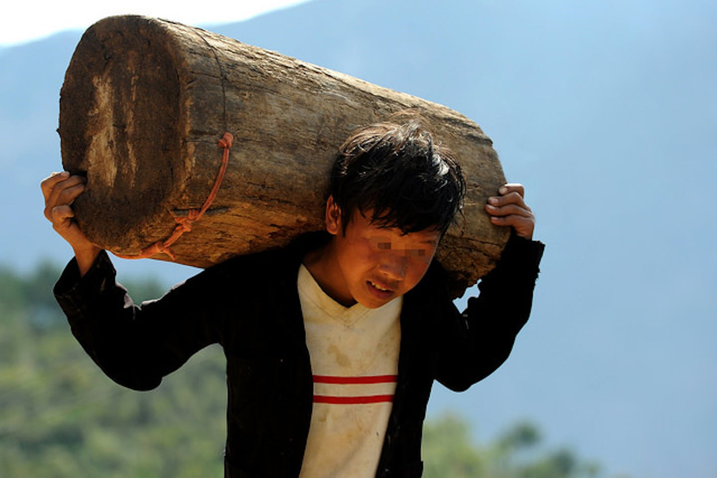boy with heavy load