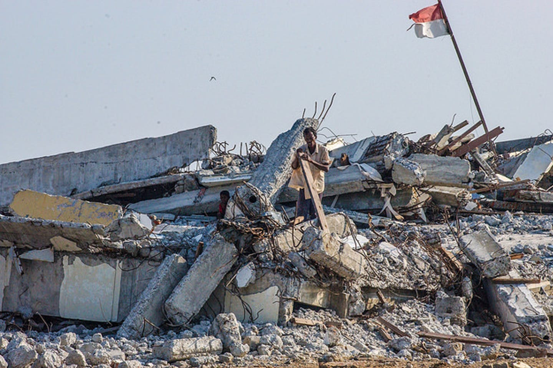 Man in India picks scrap wood after Asian Tsunami
