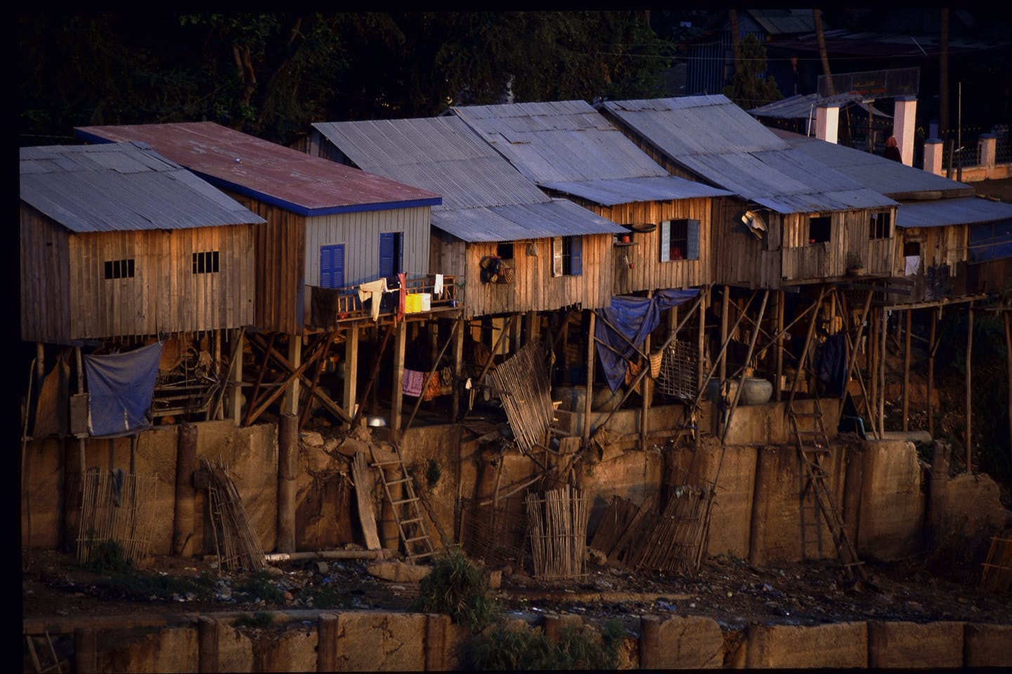 Houses of urban poor built along Basac river bank in Phnom Penh.