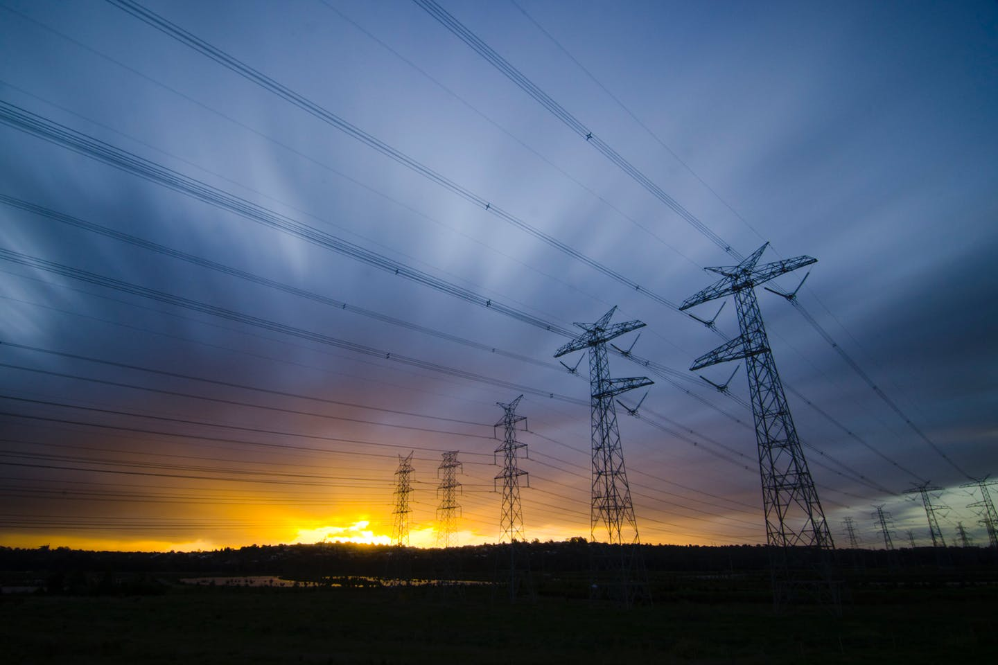 dawn over power lines in australia