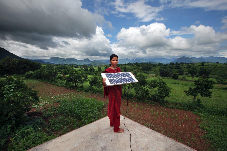 girl in Orissa with solar power