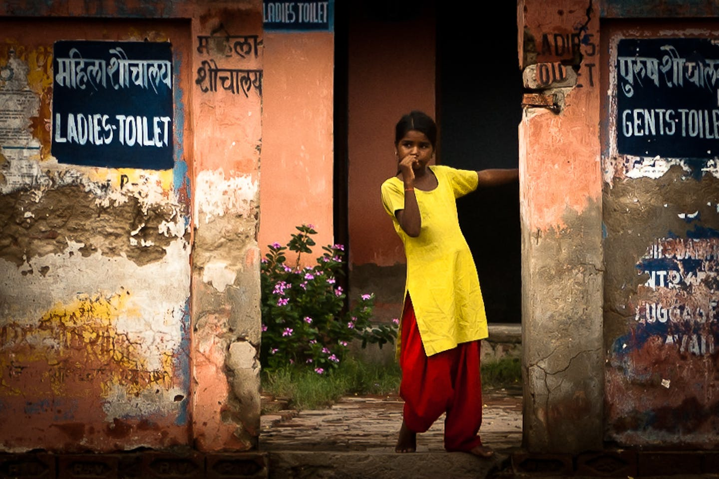 little girl stands at toilet in Fatehpur Sikri, India