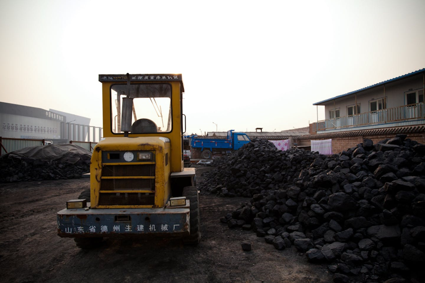 coal at seemingly abandoned construction site in China