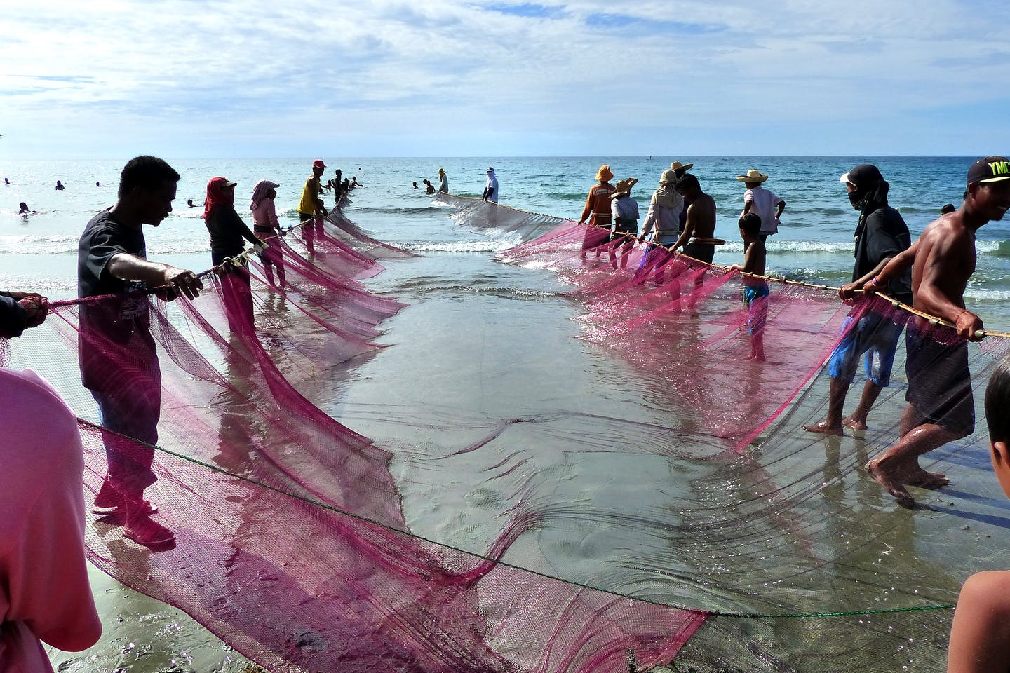 Fishermen and their corral net in the Philippines