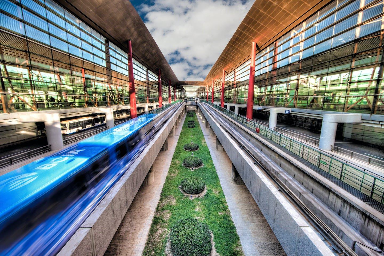 Monorail shuttles whisk passengers through the Beijing Airport.
