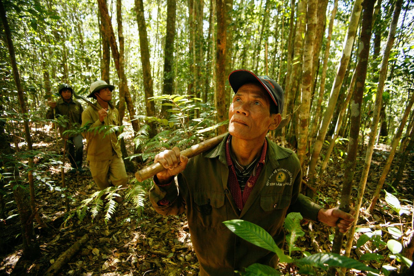 Locals patrol the forest in Vietnam