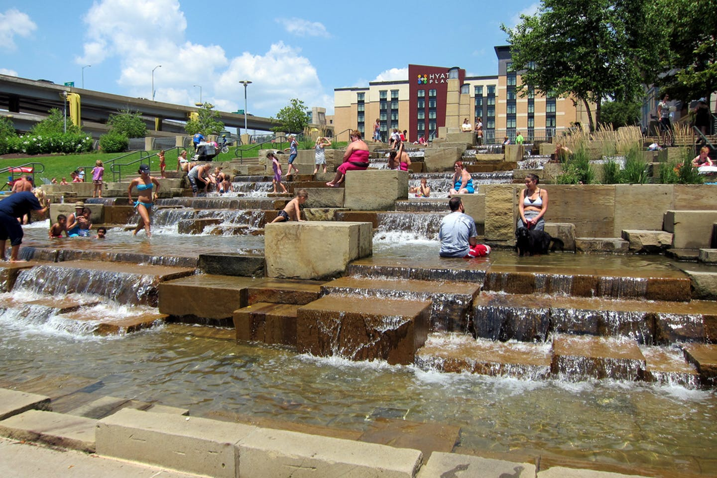 People of Pittsburgh cooling off in a public water fountain