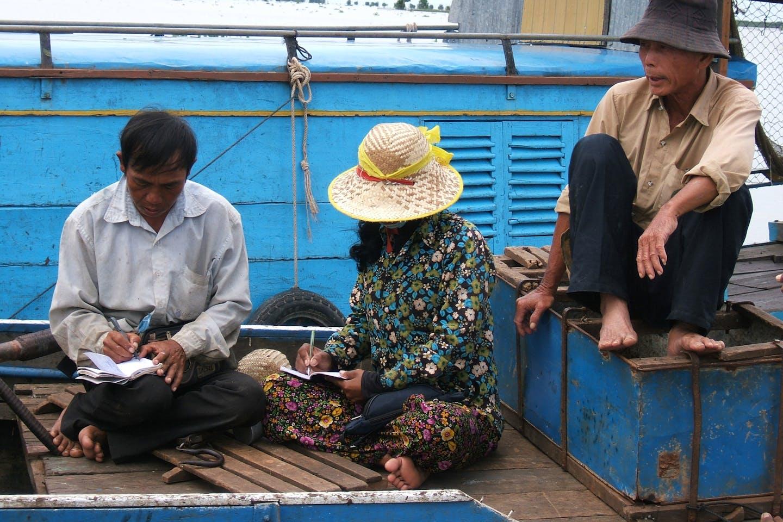 Fishermen in Cambodia balancing their accounts.