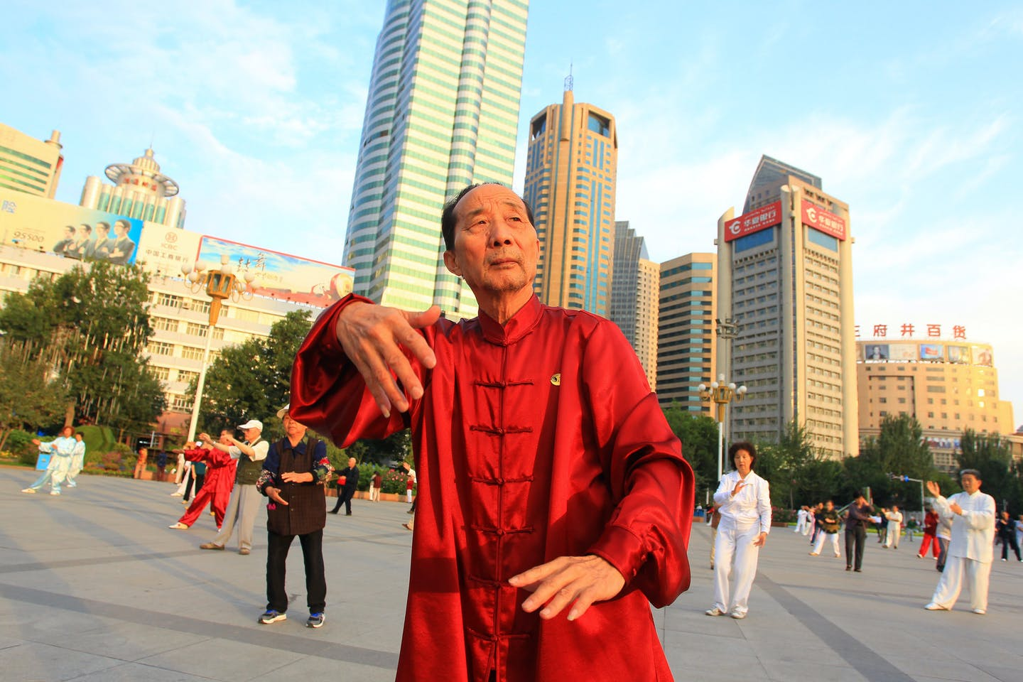 People do taichi in the People's Square of Urumqi, China