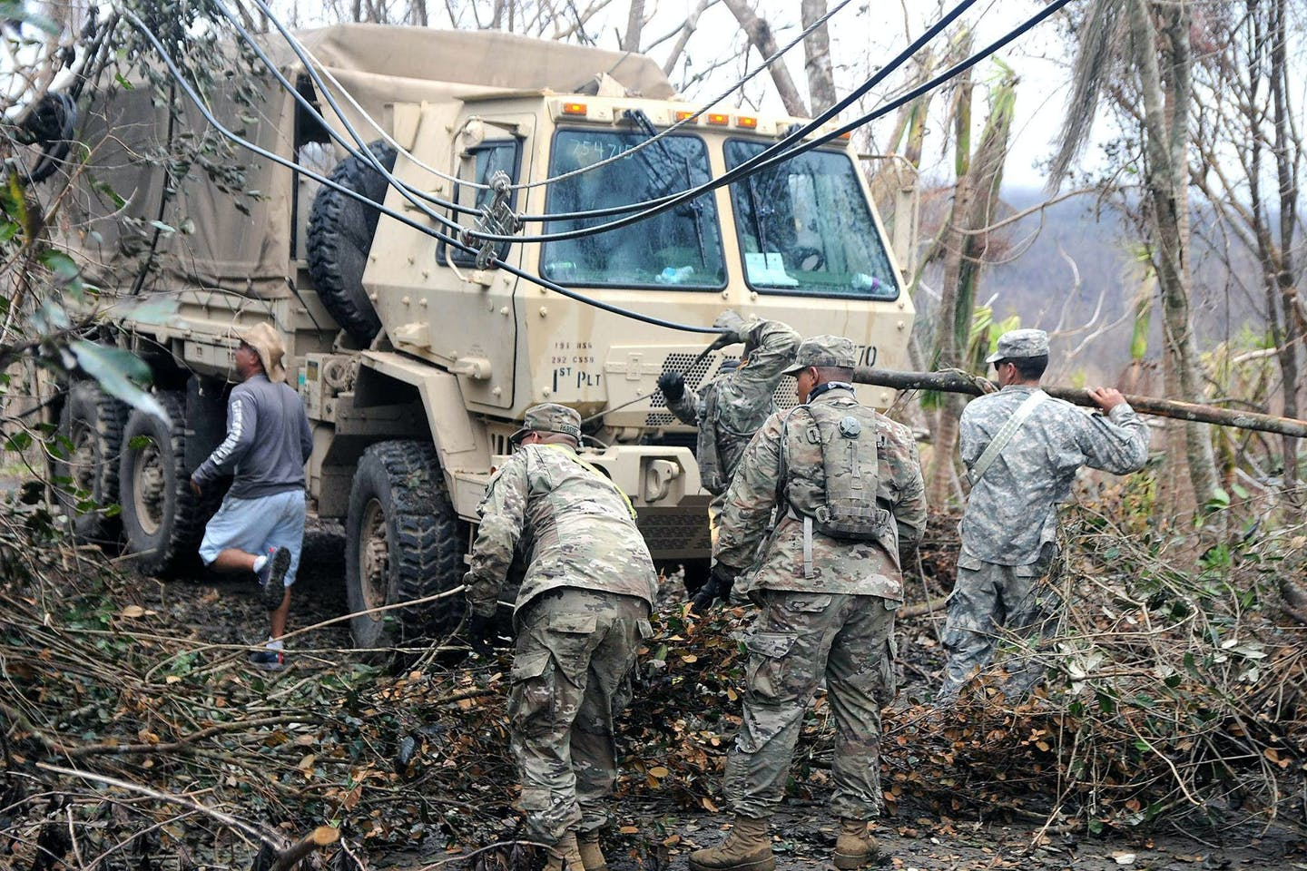 The Puerto Rico Army National Guard clearing the roads after Hurricane Maria