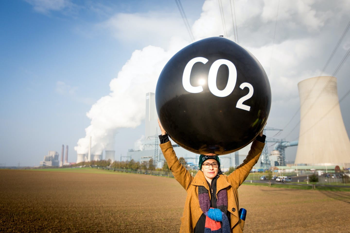 Person protesting against fossil fuel energy stations at COP23