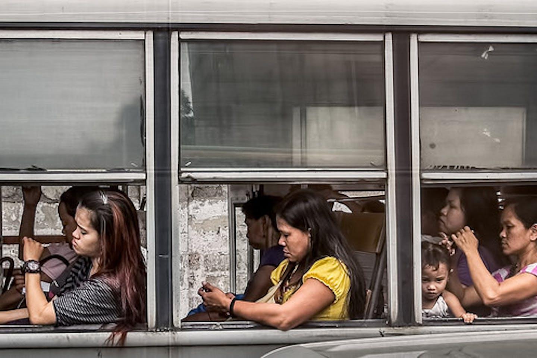 women in a bus Manila