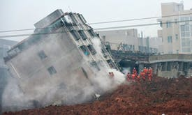 Waste spill buries buildings in southern China, 85 missing