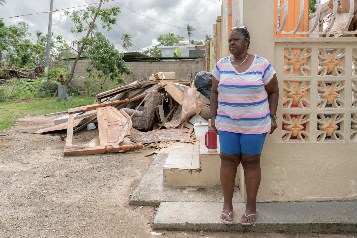 A woman in Loiza at her damaged home in Loíza, Puerto Rico