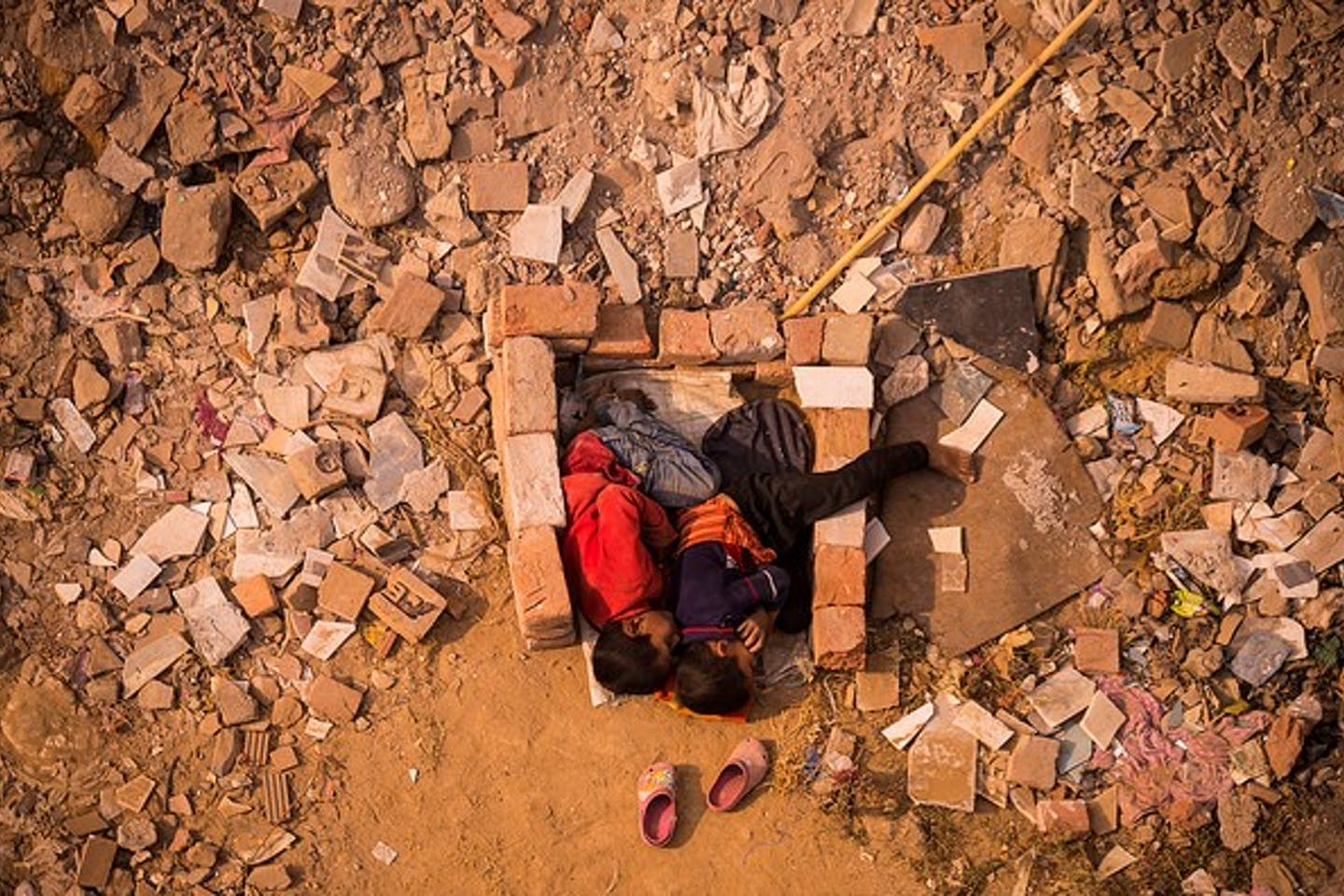 children play in dirt and bricks