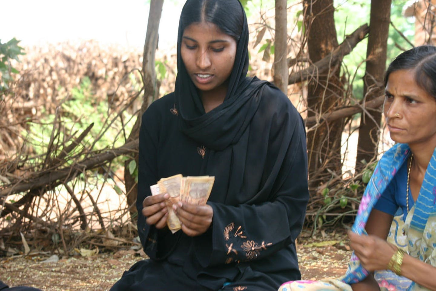 india woman counting money
