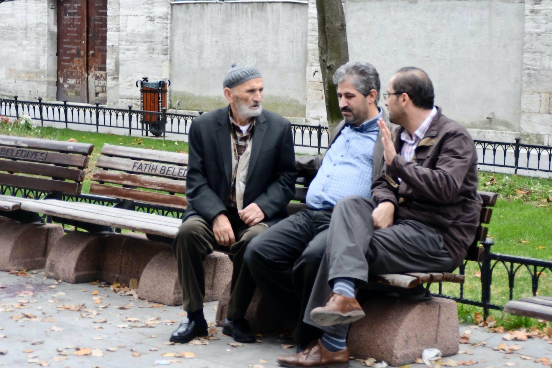 Men in conversation in Istanbul.