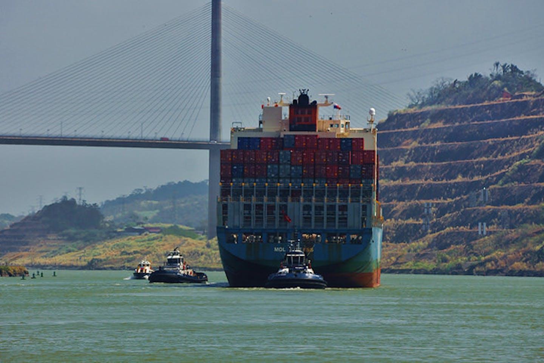 A cargo ship under The Bridge of the Americas