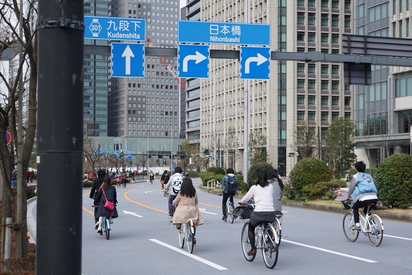 Cyclists on the road in Tokyo, Japan