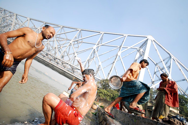 people bathing india water