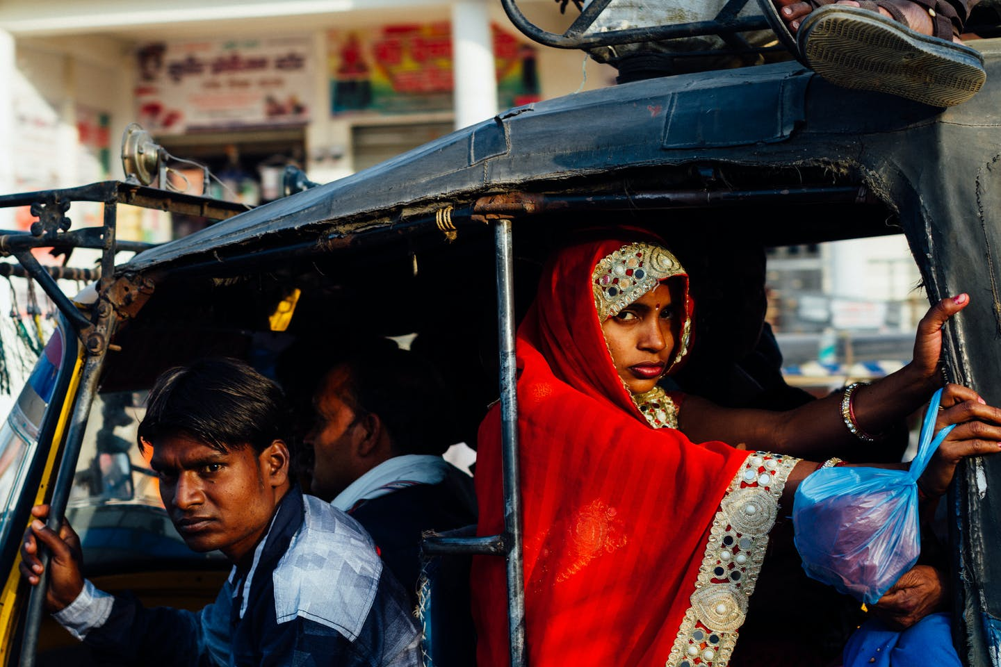 A woman rides in the back of an auto-rickshaw in Uttar Pradesh, India.