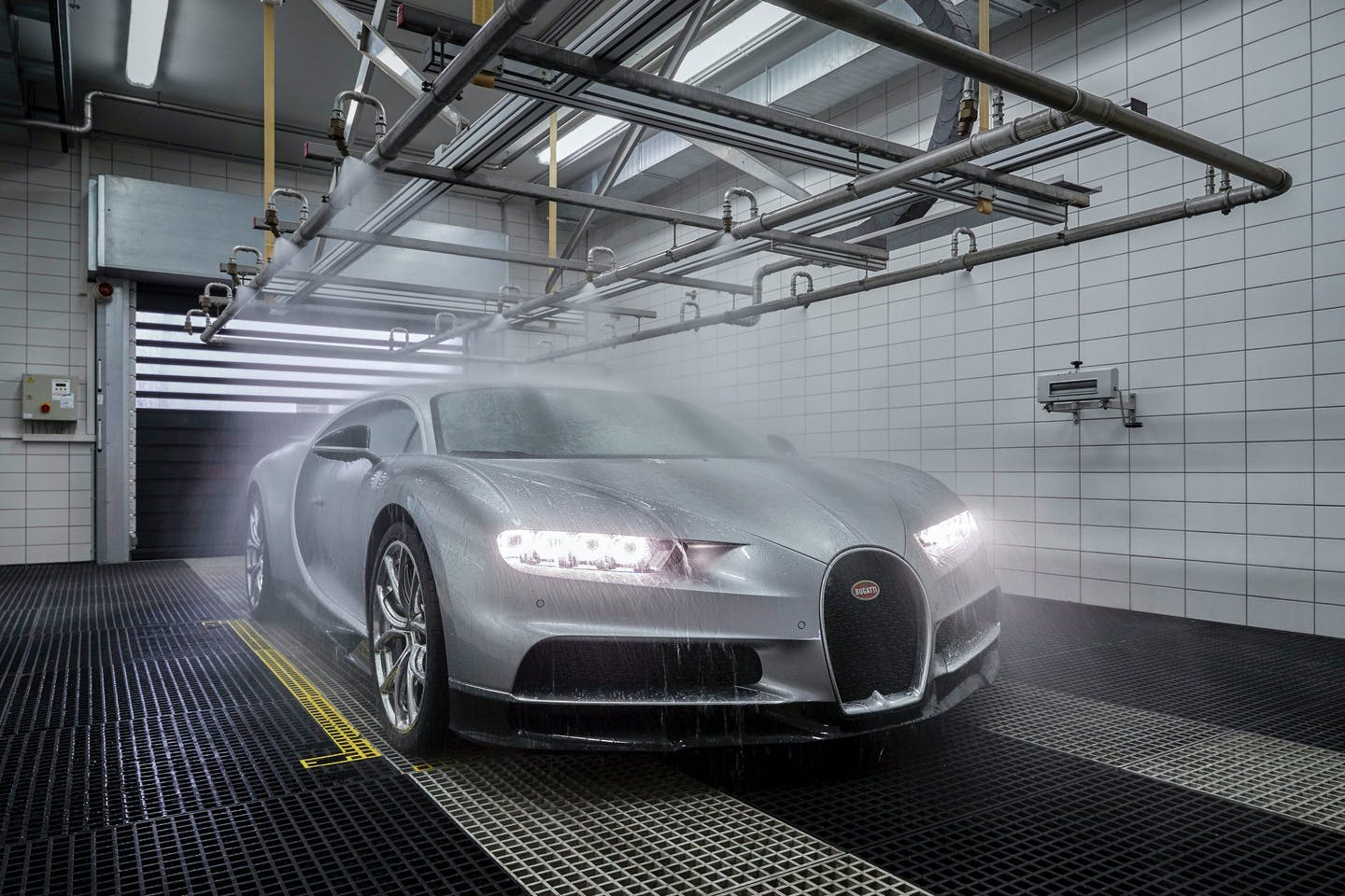 A sports car getting a wash at the factory