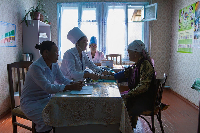 Doctors attend to elderly patient