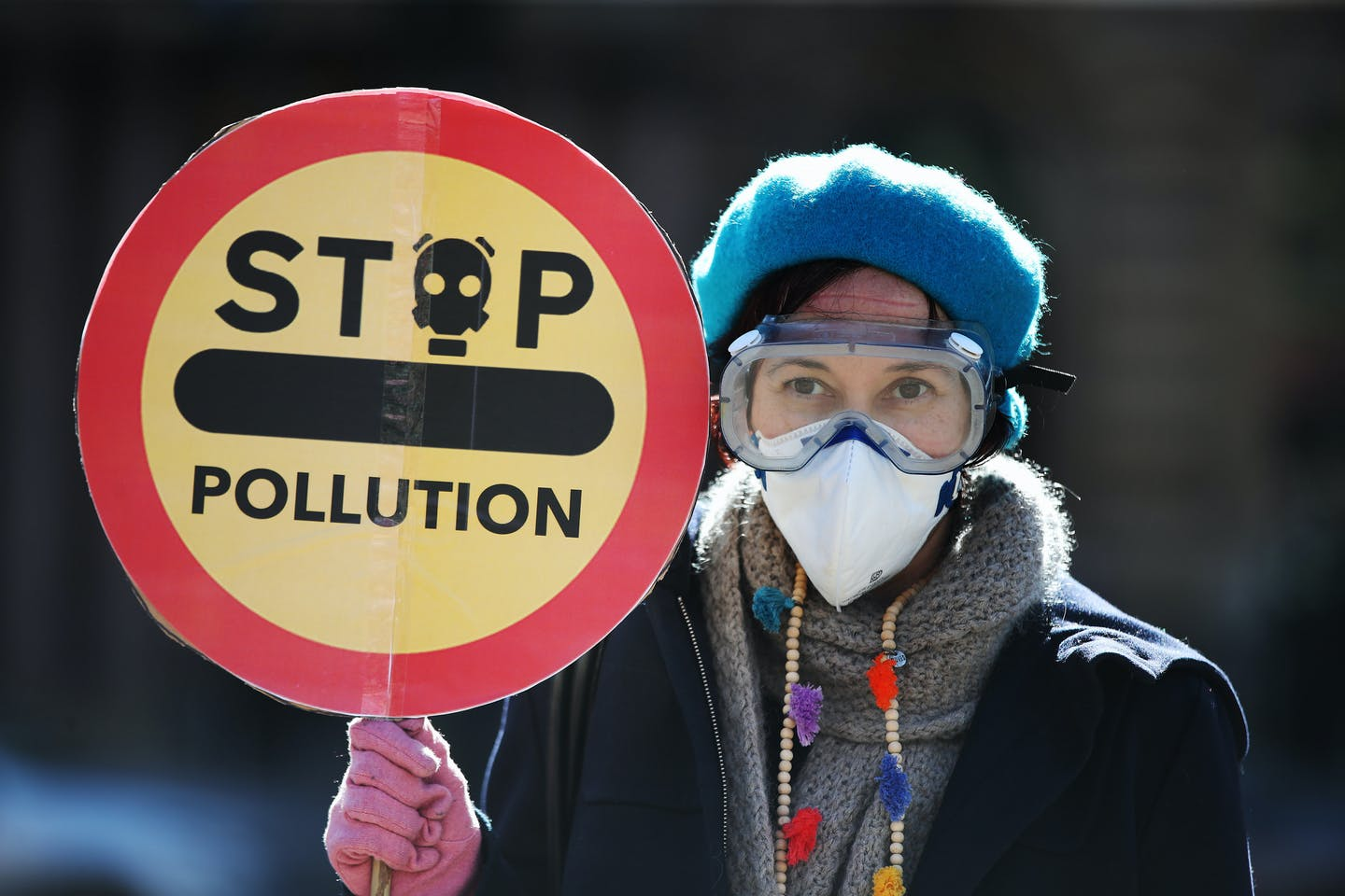 A Friends of the Earth protester objecting to the poor air quality in Glasgow, Scotland