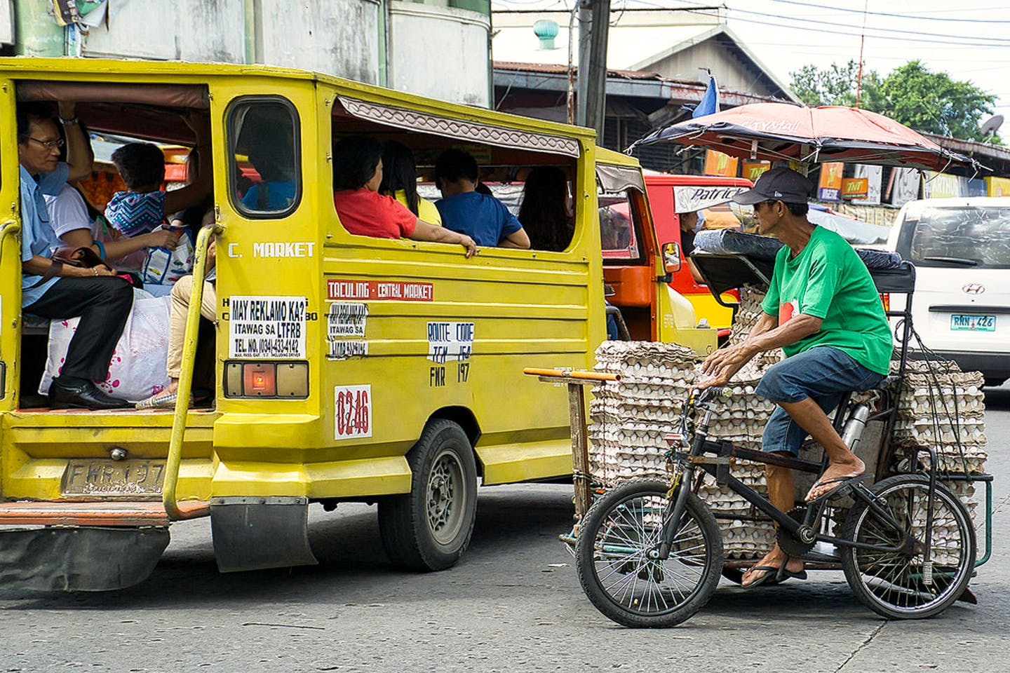 A man sells eggs in a tricycle in Bacolod City, the Philippines