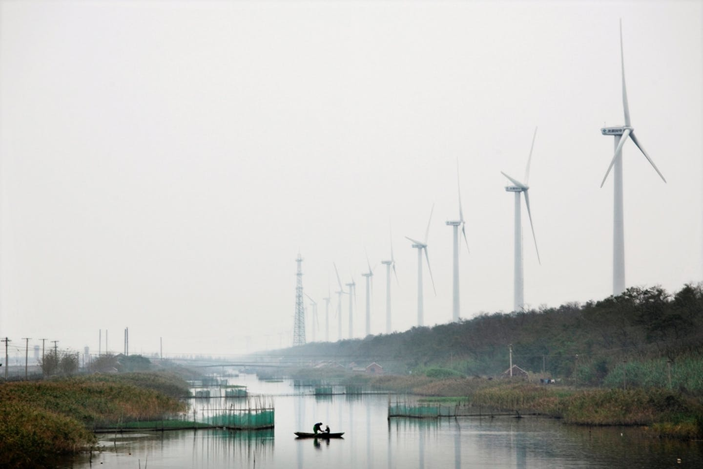 A wind farm beside a river in China