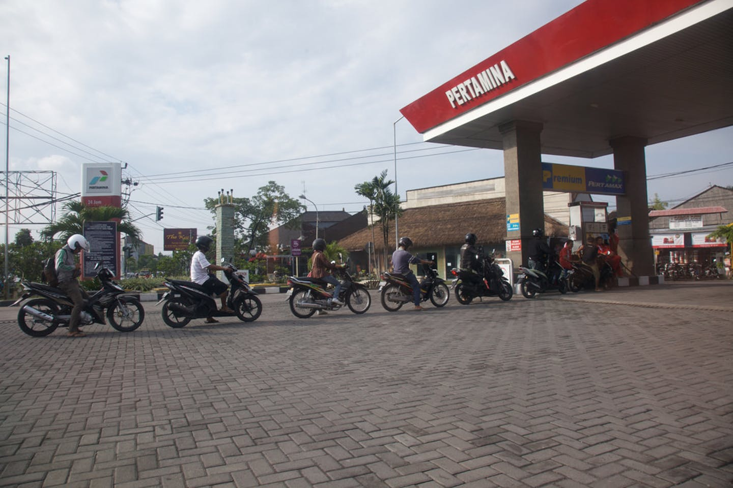 Motorists queue for fuel at a petrol kiosk in Seminyak, Bali.