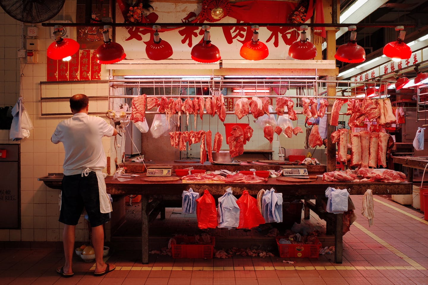 man selling meat china