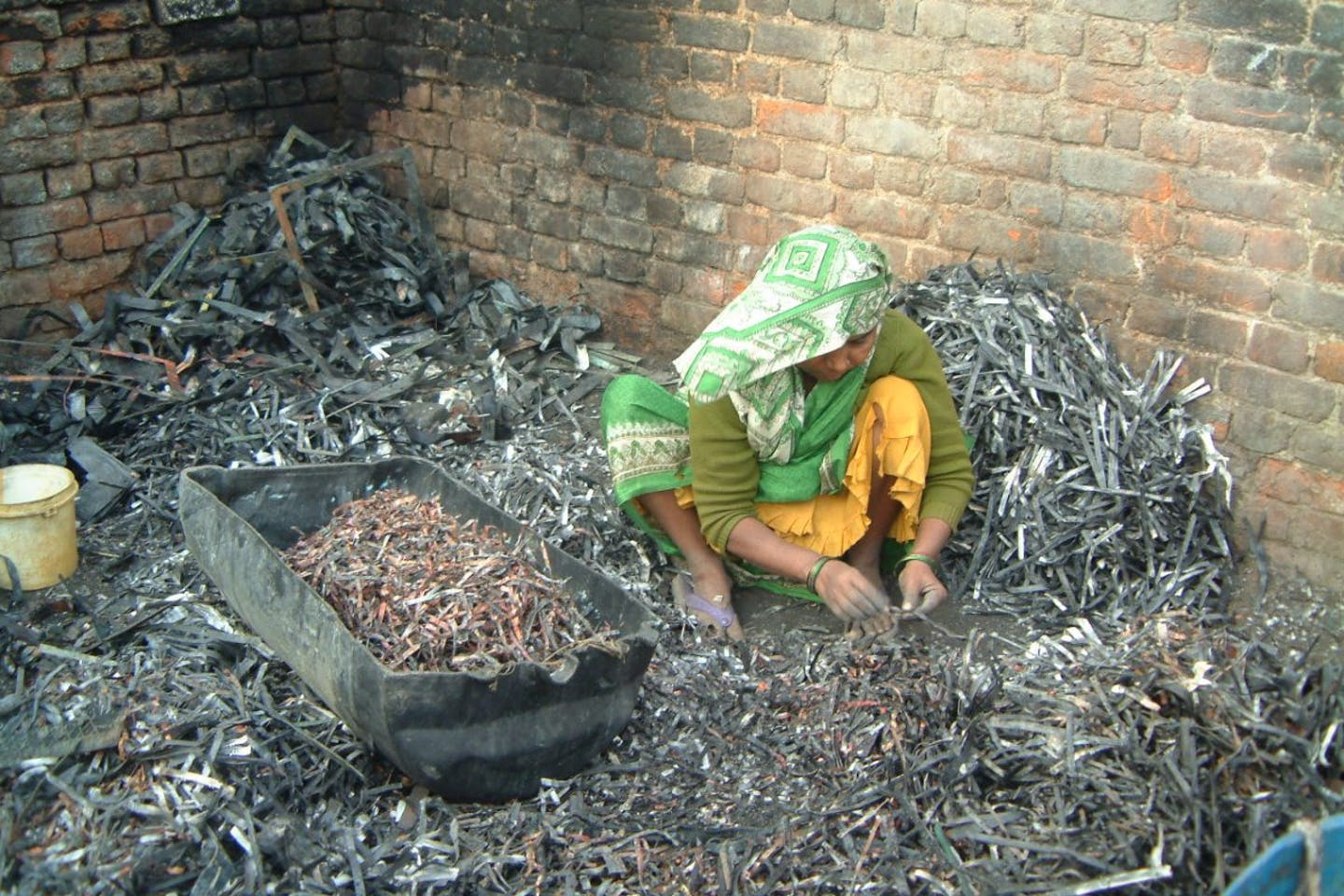 e-waste being processed by hand in India