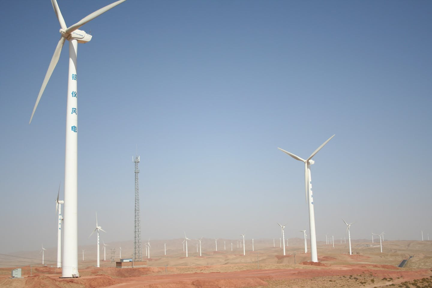 Wind turbines on a solar farm in Ningxia Province in Northern China
