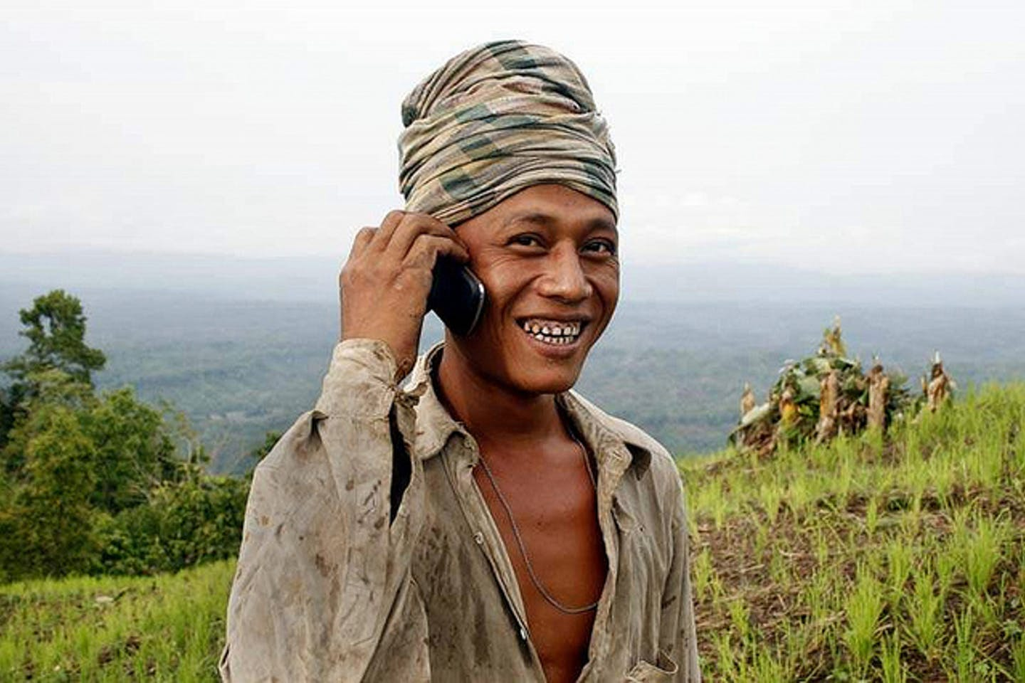 happy farmer on the cellphone